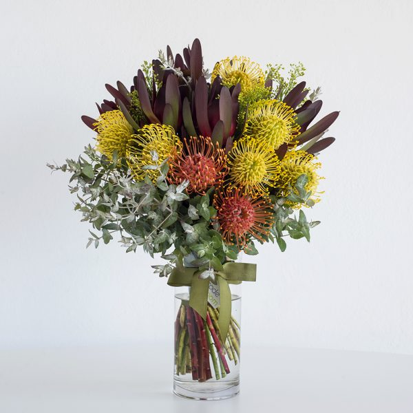 Native Flowers in Glass Vase