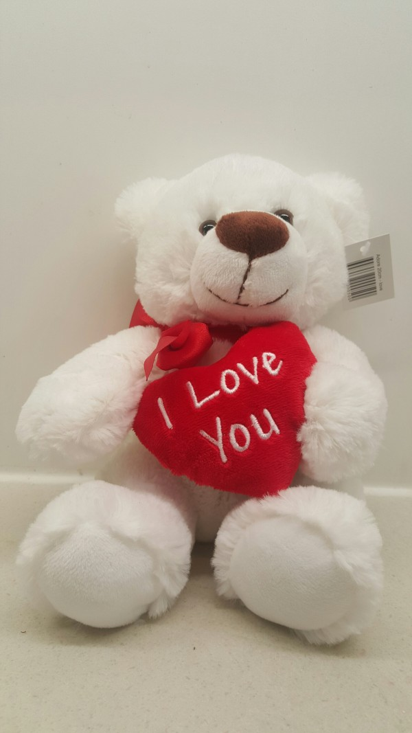 white teddybear with loveheart